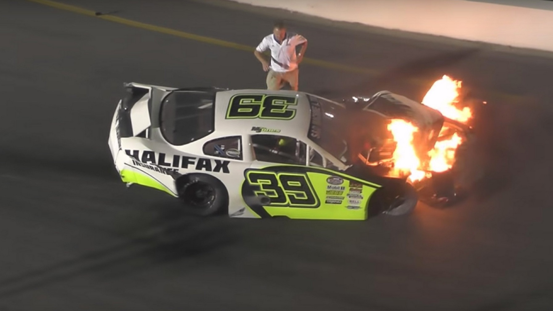 Dad Rushes Onto Track To Free His Son From A Burning Racecar