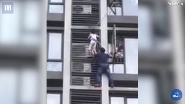 Fearless Dad Scales Side of Building to Save Son