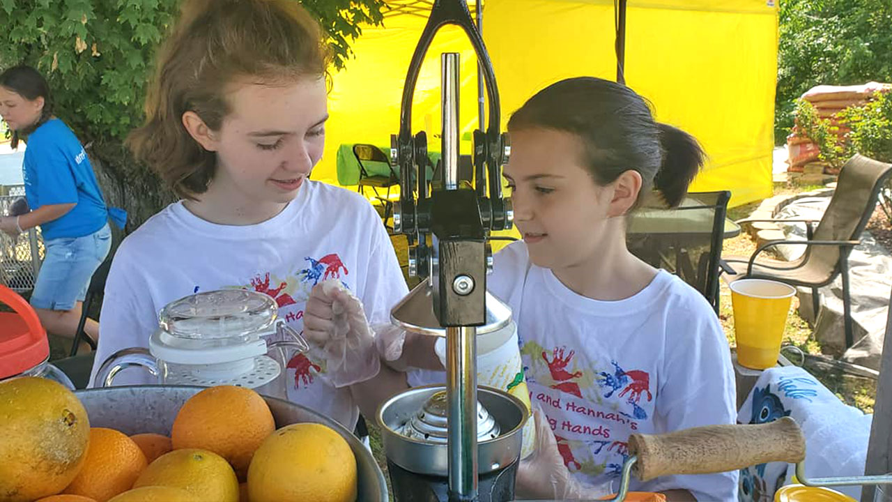 Sisters Run Lemonade Stand to Help Pay off Other Student's Lunch Debts