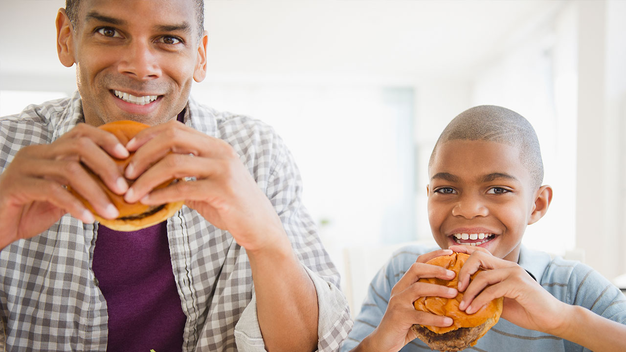 Dad and son eating fast food