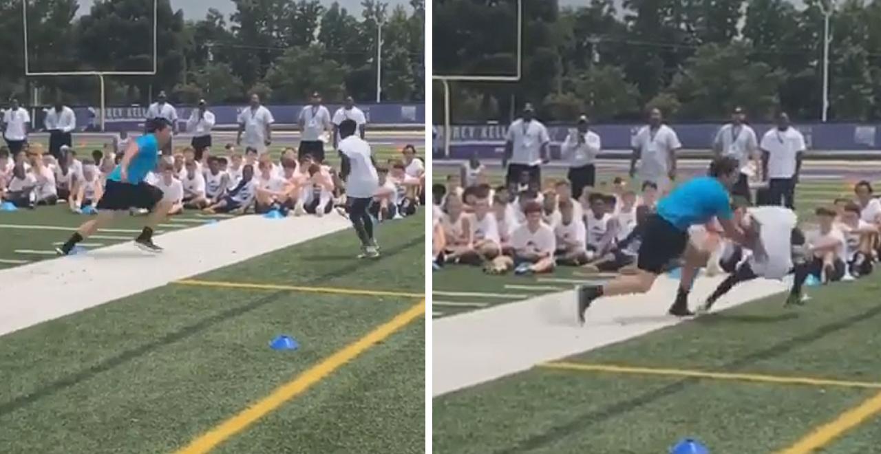 Linebacker Levels Kid at Football Camp