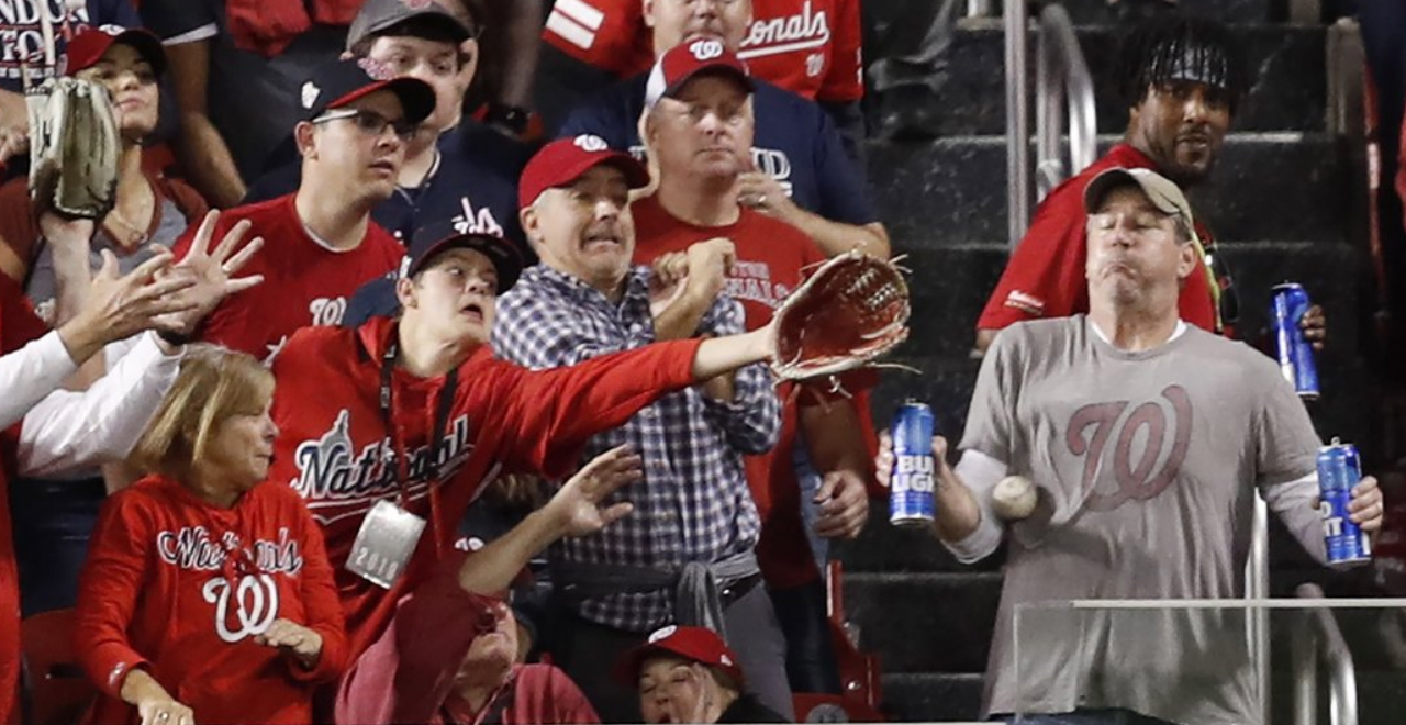 Fan Takes Homer to Chest to Save Beers