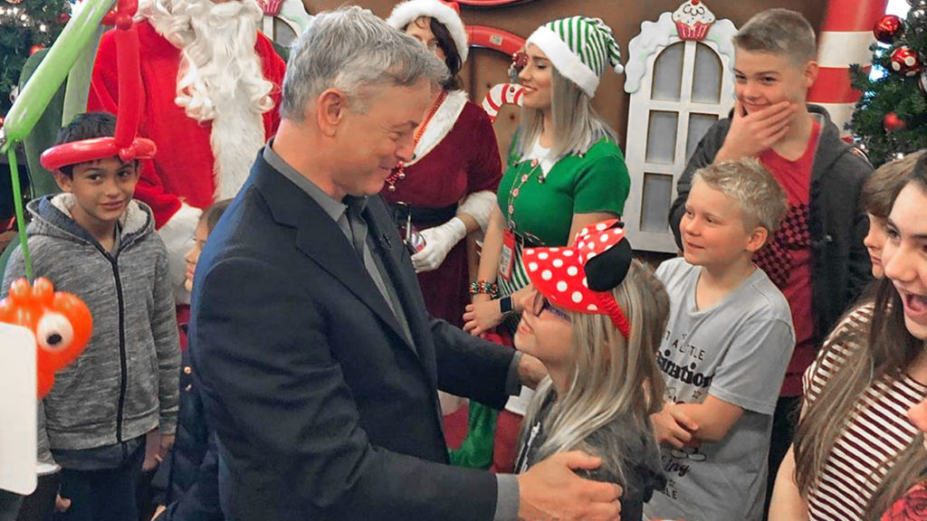 Gary Sinise at Airport with kids taking off for Disneyland