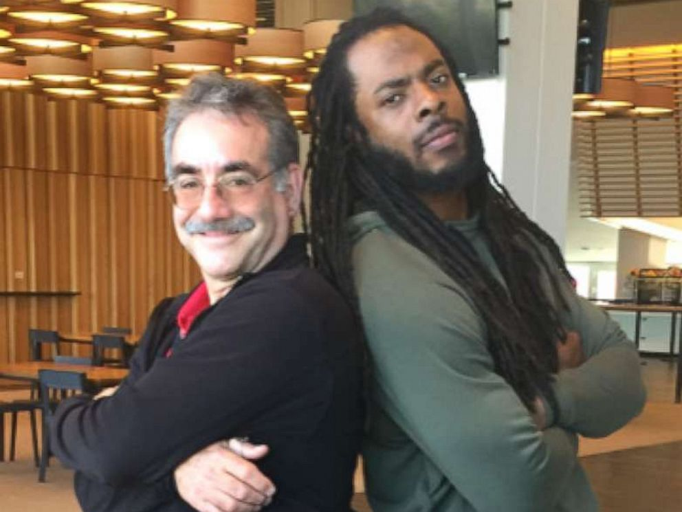 Principal Stan Garber poses with 49ers Richard Sherman