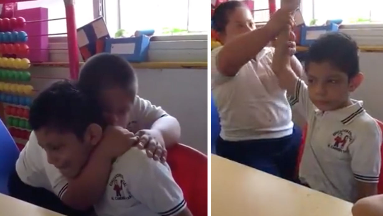 Boy With Down Syndrome Consoling Classmate With Autism