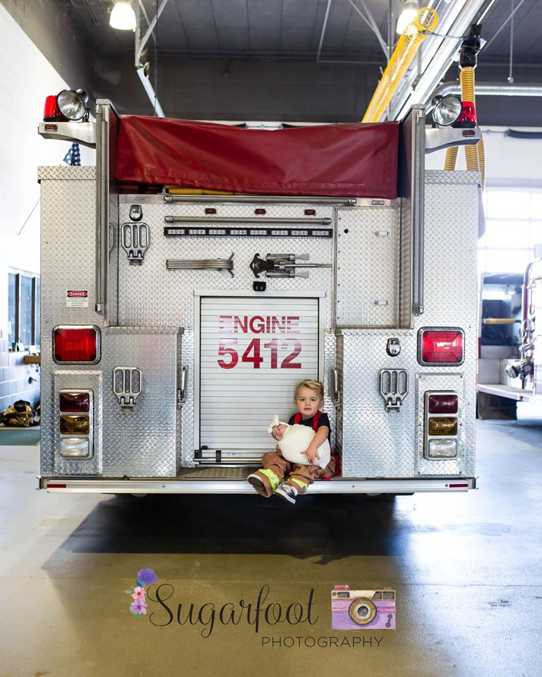 Viral Photo Shoot Features Newborn of Fallen Firefighter and His Firehouse Brothers