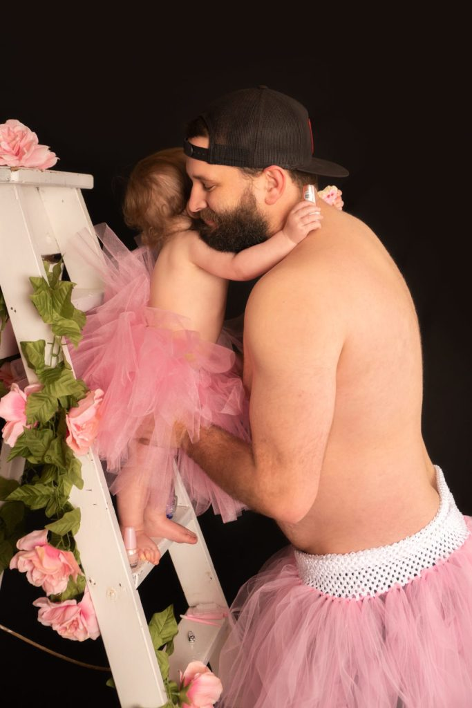 Dad and Baby Daughter Sport Matching Tutus for Epic Photoshoot
