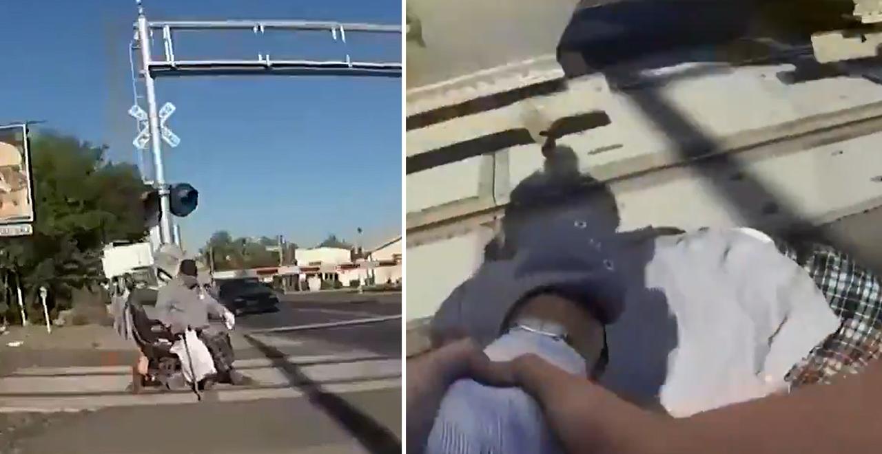 hero cop saves man stuck on tracks