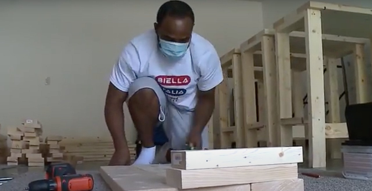 Dad builds desks for kids who need them