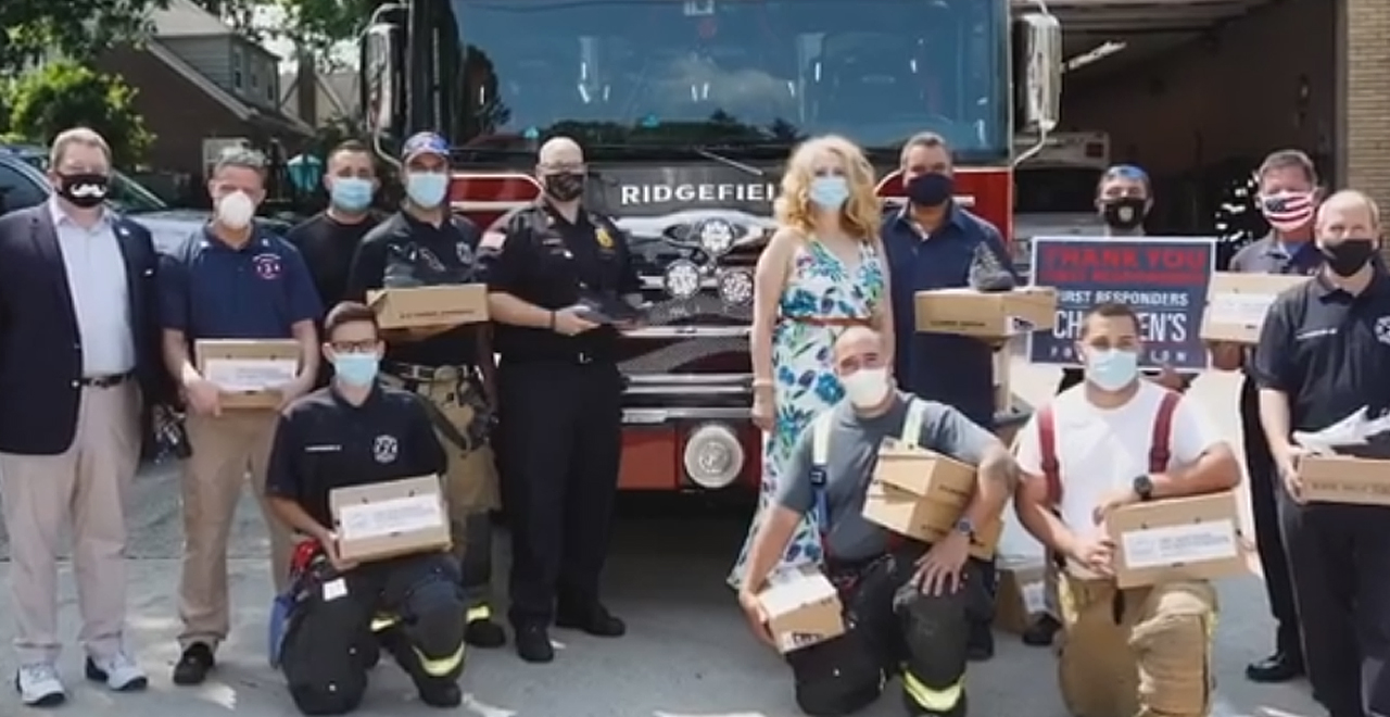 The Rock Gifts Shoes to Firefighters