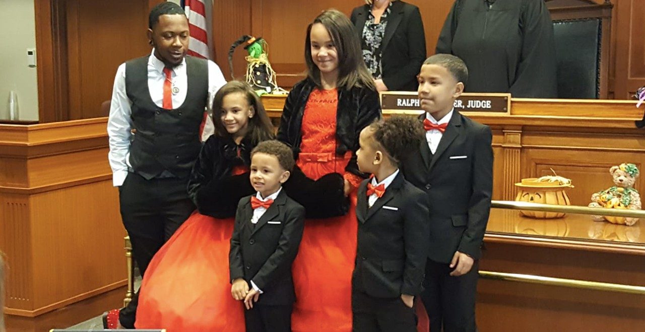 Single dad adopts five siblings to keep family together
