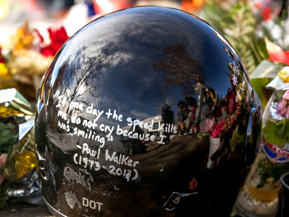 a helmet with signatures to remember Paul Walker