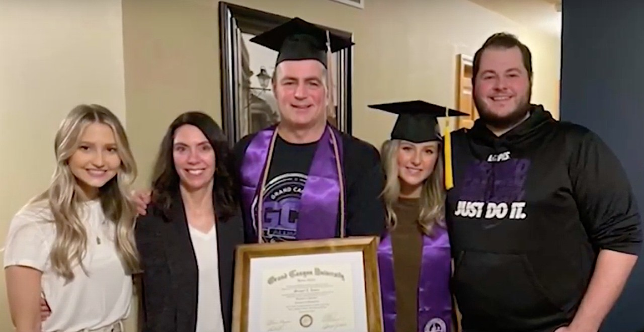 Dad graduates from same school as daughter