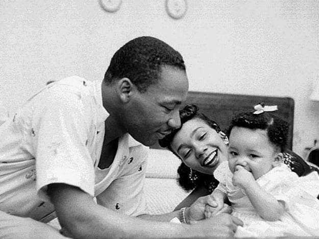 Civil rights leader Reverend Martin Luther King, Jr. relaxes at home with his wife Coretta and first child Yolanda in May 1956 in Montgomery, Alabama