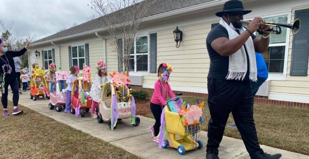 Preschoolers hold mardi gras parade for senior home