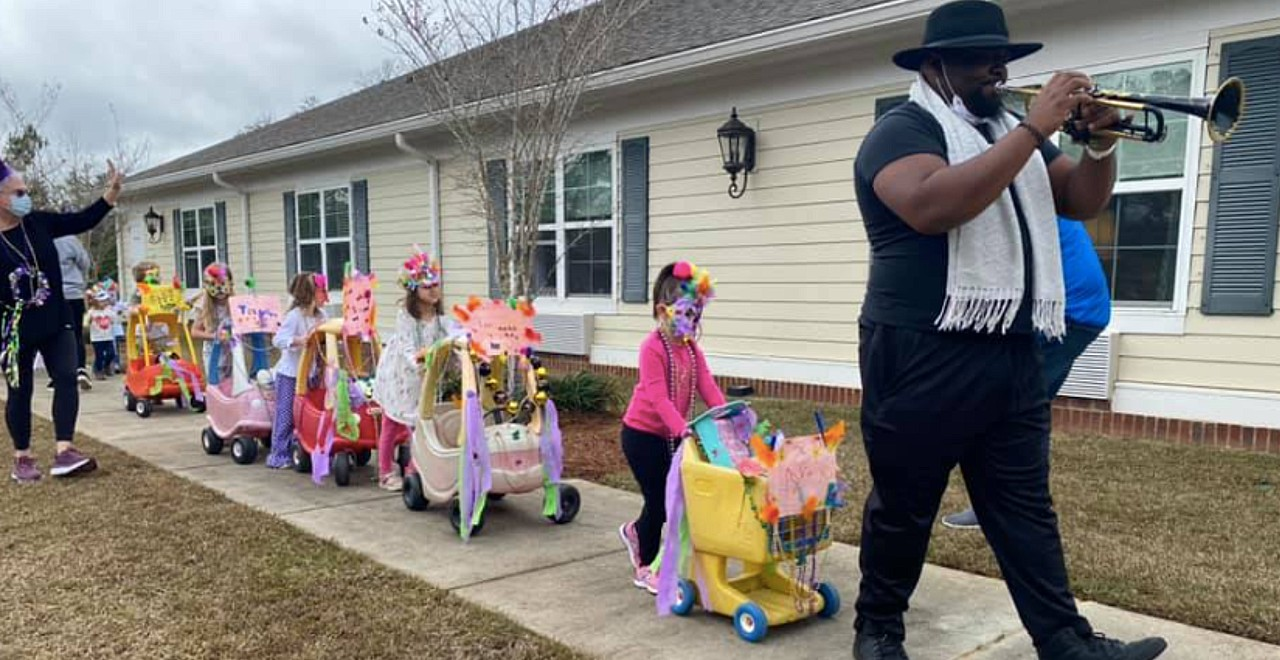 Preschoolers hold mardi gras parade for senior home