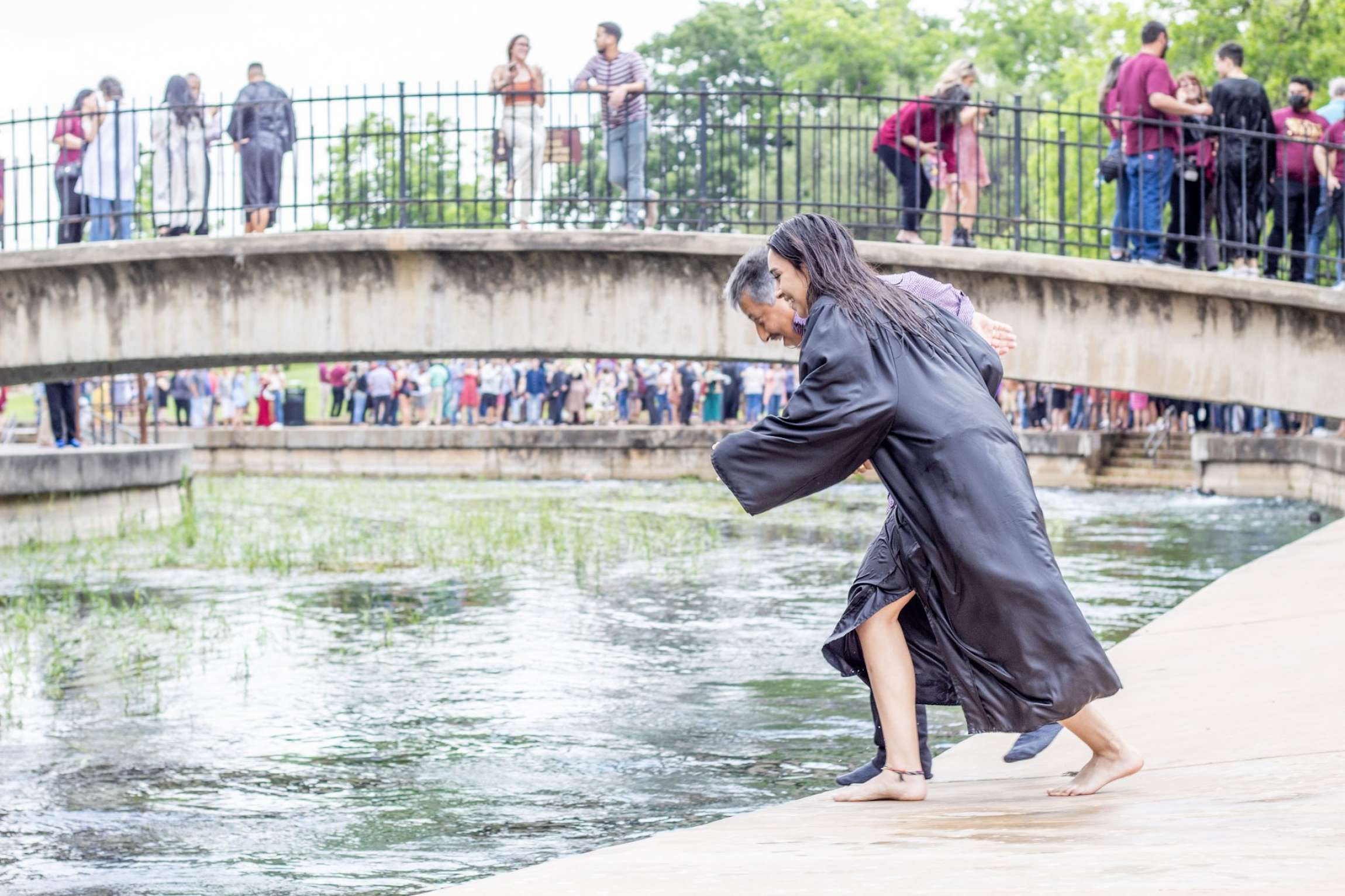 Dad and Daughter Jump Into River For Graduation