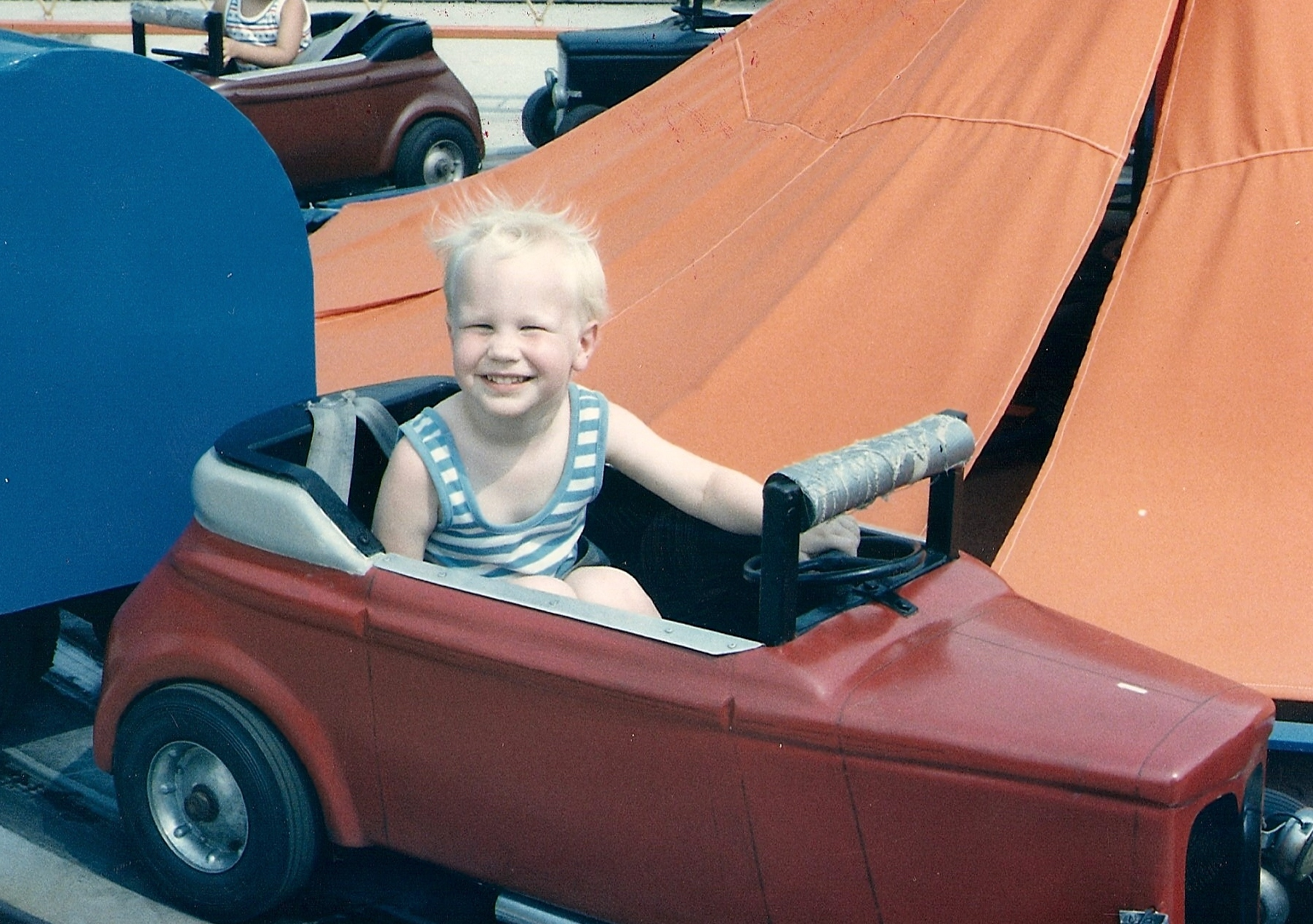 Joel Willis, 4 years old, in a car ride at Americana theme park