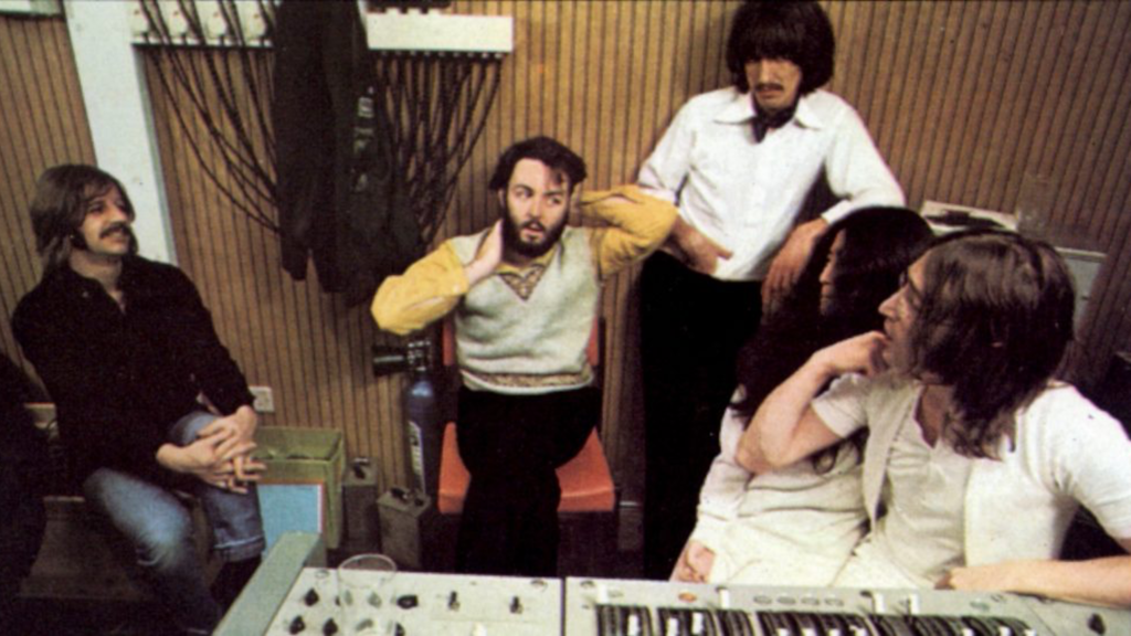 The Beatles in a recording session