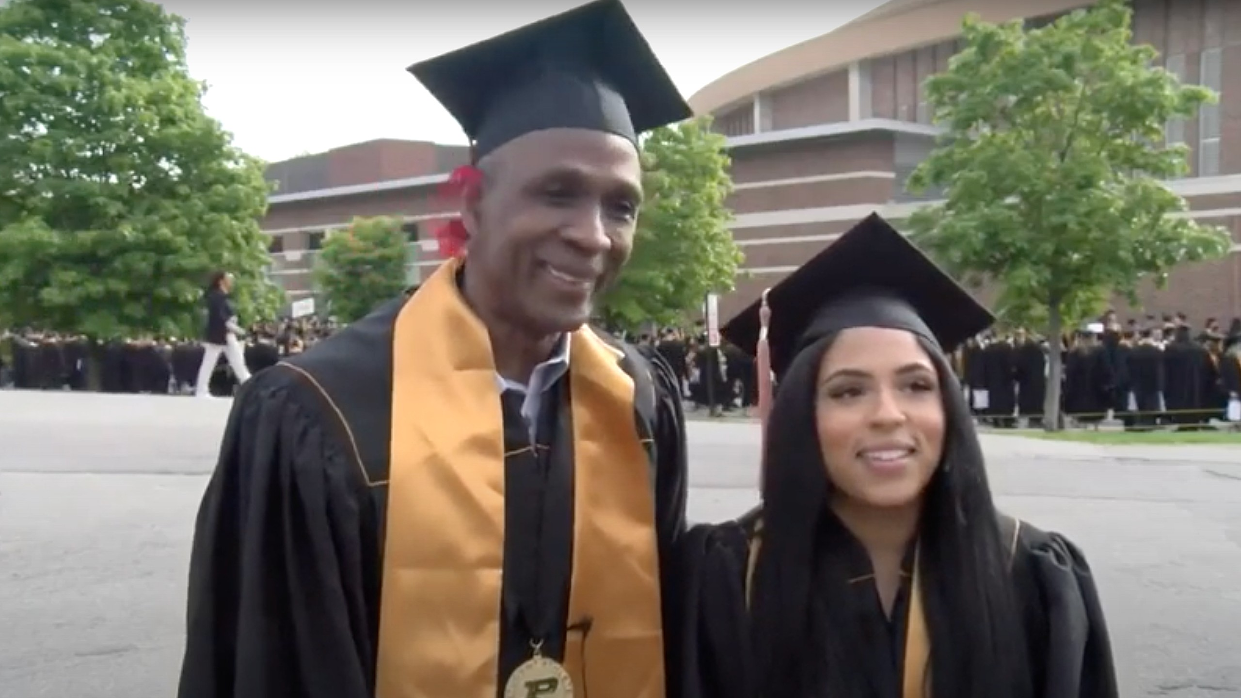 Former NFL player graduates with daughter