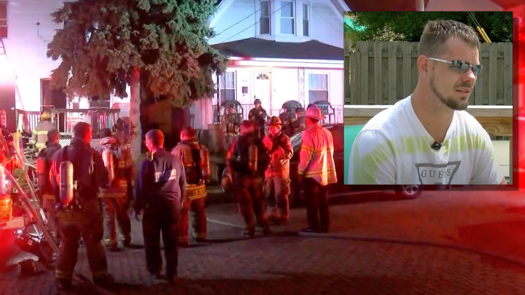Dad climbs back into burning home to save son