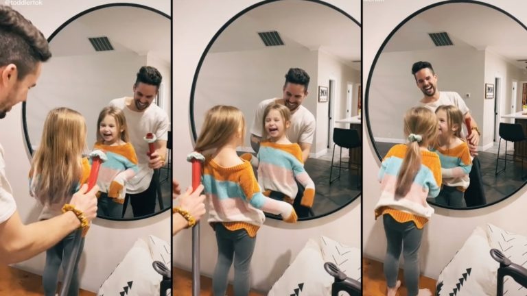 Dad hilariously uses vacuum to style daughter's hair