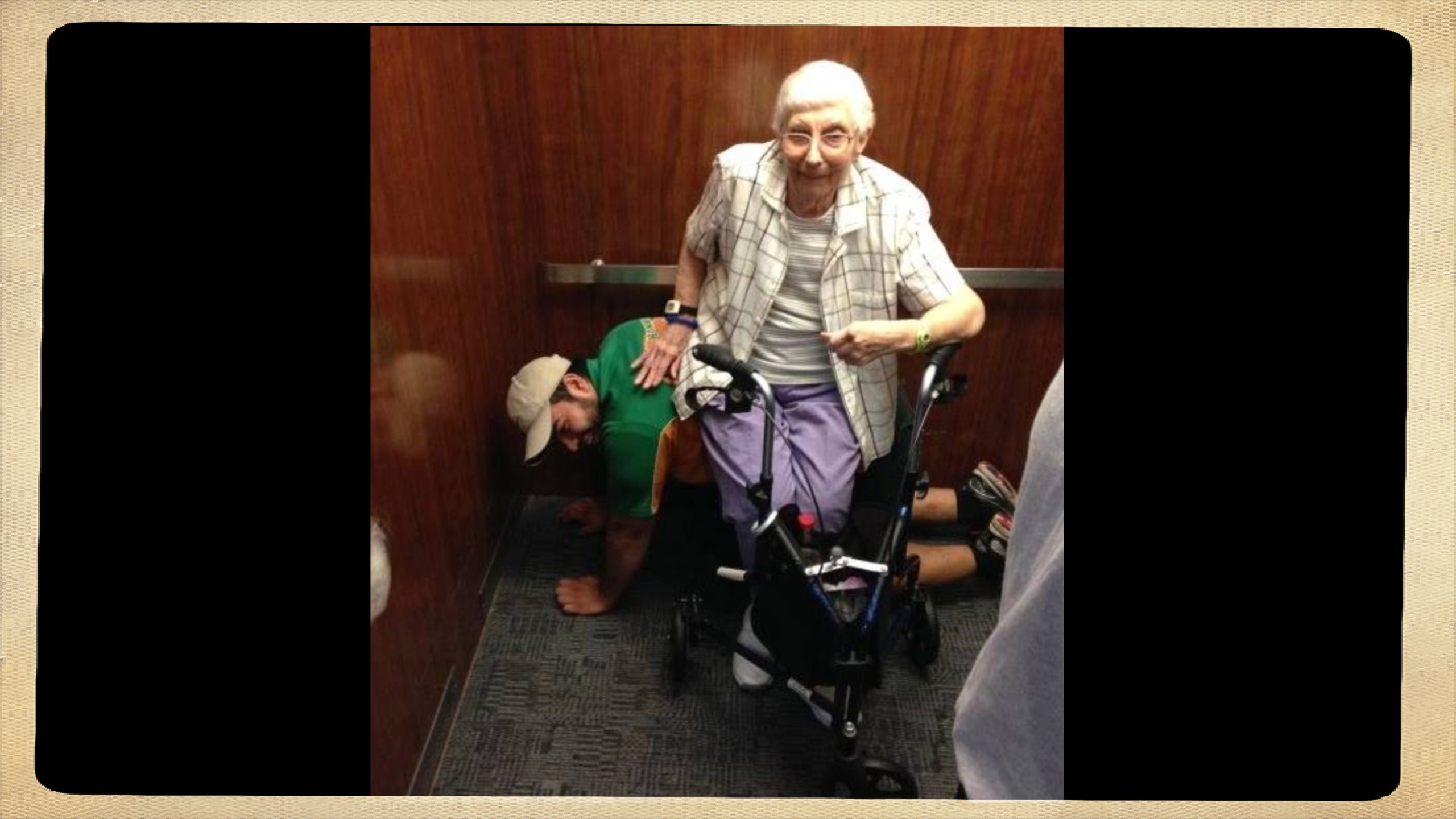 Student acts as human bench after getting stuck in elevator with elderly woman
