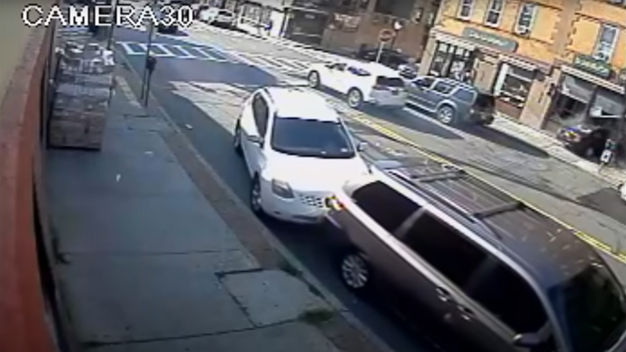 Heroes Lift Car Off Baby