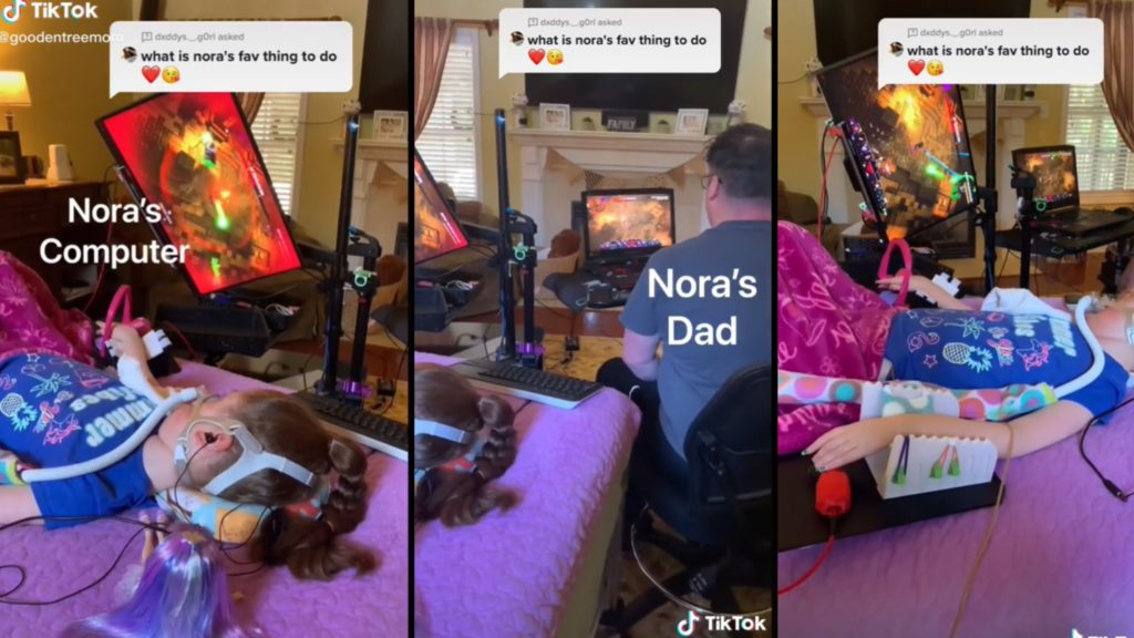 Daughter Using Adaptive Technology to Play Games With Dad