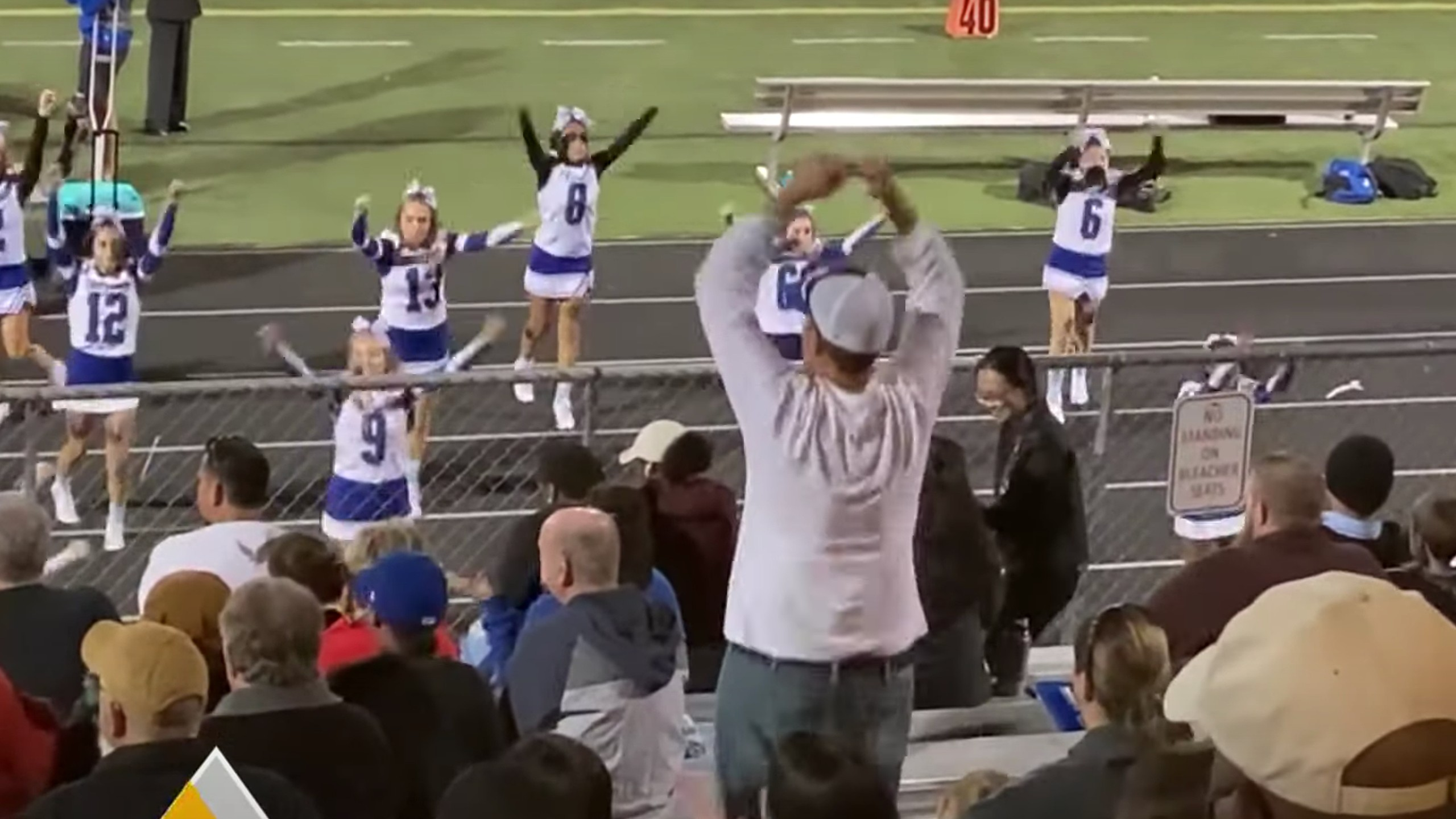 Cheer dad goes viral for unique support of his daughter's cheerleading